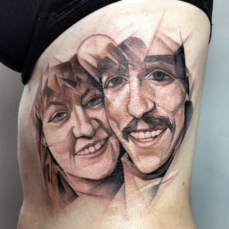 Amazing cubism faces tattoo