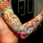 Colourful full arm tattoo