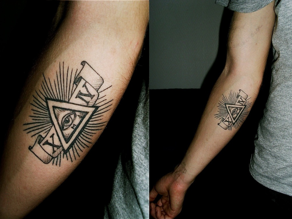 another illuminati arm tattoo