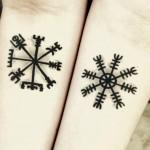 Arm symbols tattoo