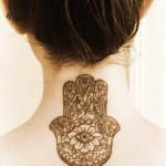 Back neck tattoo