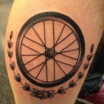 Bike wheel tattoo