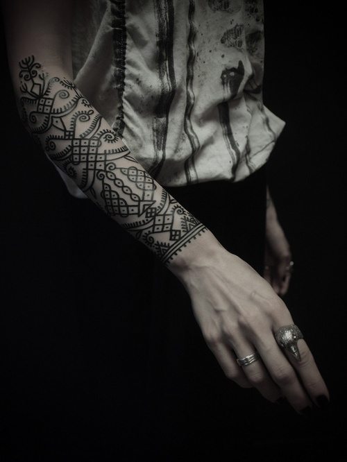 Black and white arm tattoo