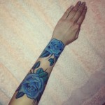 Blue flowers arm tattoo
