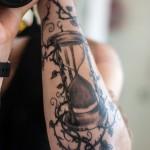 Cool sandclock arm tattoo