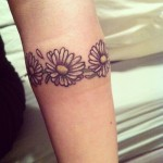 Cute daisy tattoo
