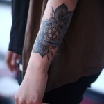 Cute floral arm tattoo