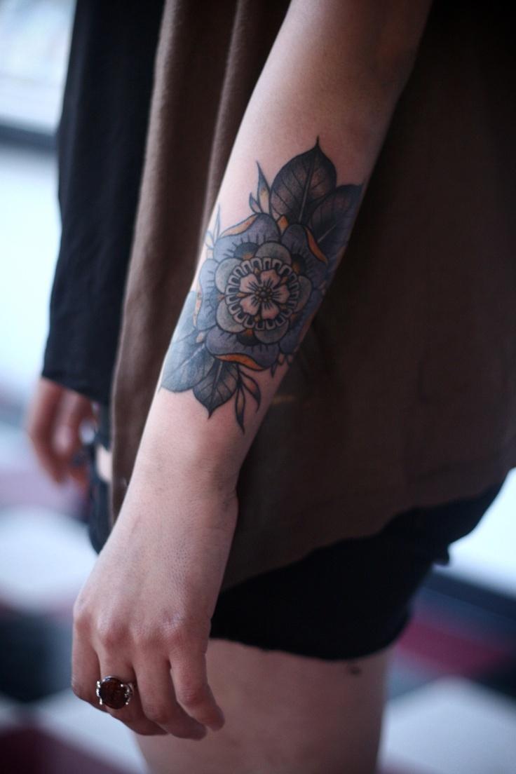 Cute floral arm tattoo
