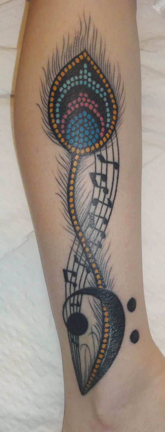 Feather and music tattoo