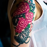 Flowers and clock sleeve tattoo