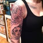 Girl's sleeve tattoo