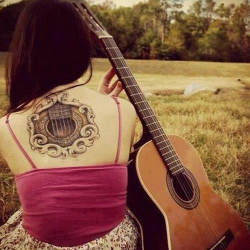 Guitar back tattoo