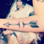 Minimal arrow tattoo