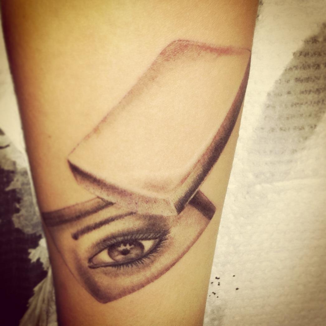 Strange eye tat