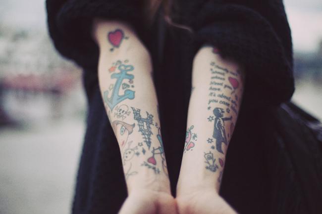 Banksy arm tattoo