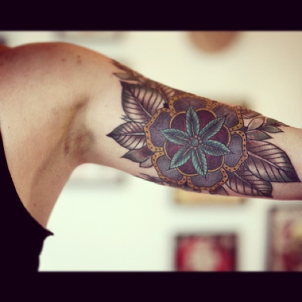 Beautiful floral guy's arm tattoo