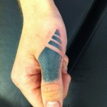 Black finger tat