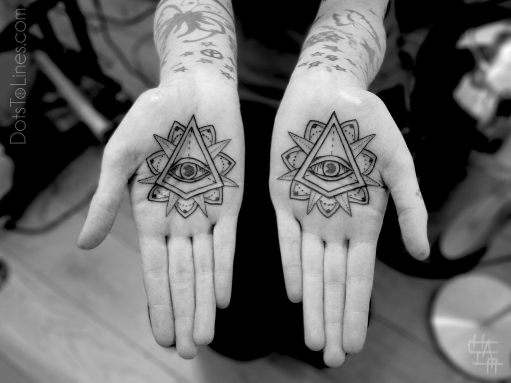 Eyes hands tattoos