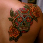 Floral skull back tattoo