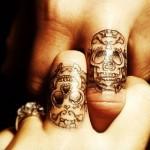 Minimal skull finger tattoo