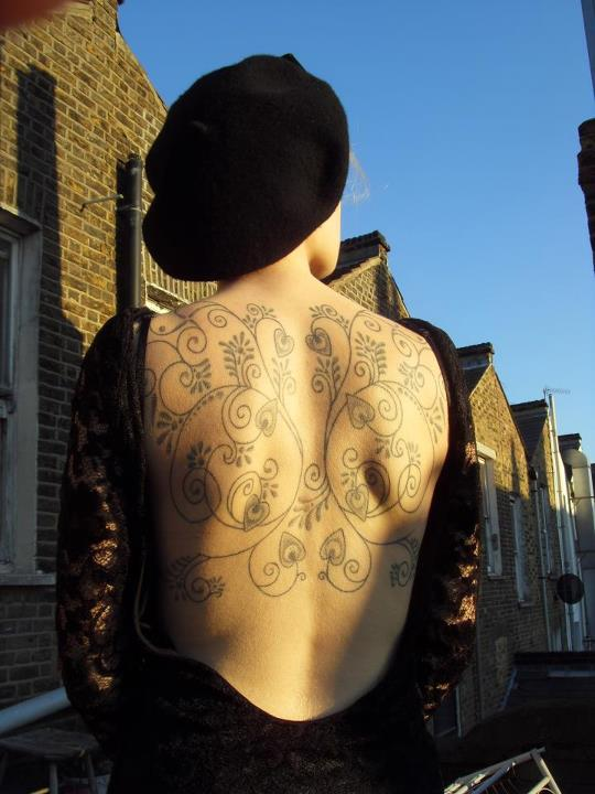 Beautiful Back Hearts Tattoo