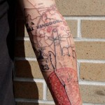 Abstract Black & Red Arm Tattoo