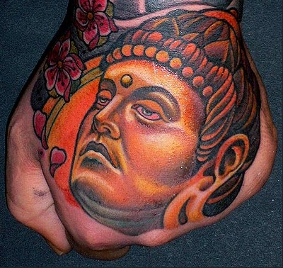 Buddha On Hand Best Tattoo Design Ideas