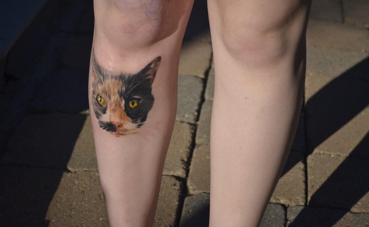 Cat Face On Leg