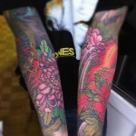 Floral Arm Tattoo Idea