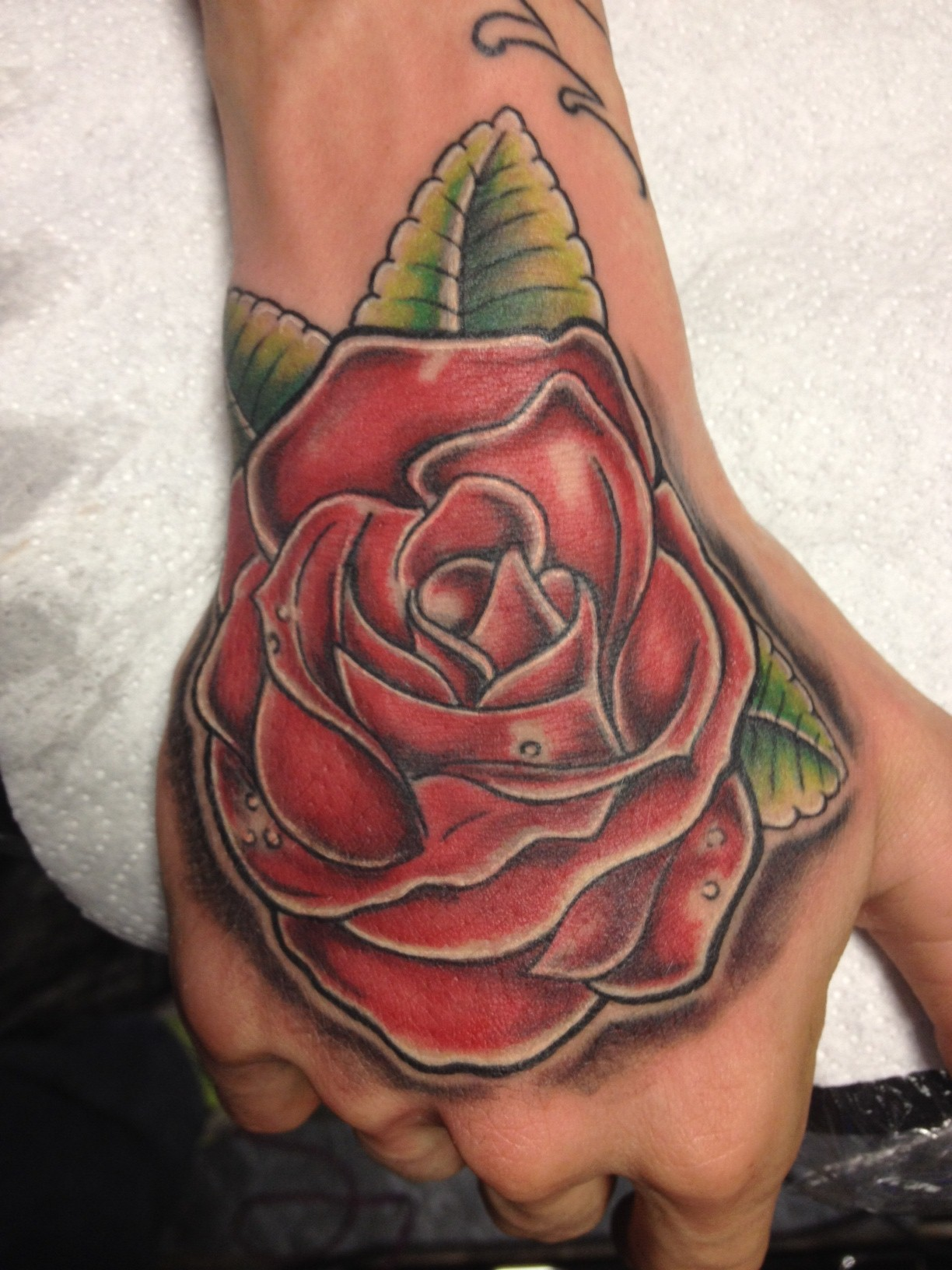 hand rose best tattoo design ideas