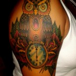 owl arm tattoo