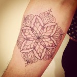 Simple Floral Inner Arm Tattoo