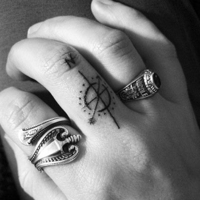 Minimal Compass Finger Tattoo