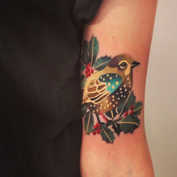 Stylized Bird Tattoo On Inner Arm