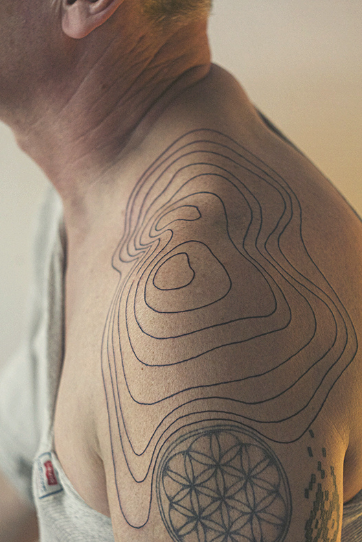 Relief Lines Shoulder Tattoo