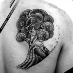 tree tattoo on shoulder blade