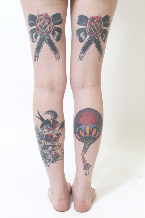 Traditional Tats On Both Legs