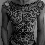 Amazing Tribal Chest Tattoo Design