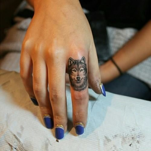 Small Wolf Tattoo On Finger