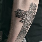 black floral cross tattoo