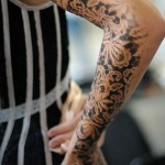 Black Lace Arm Tattoo