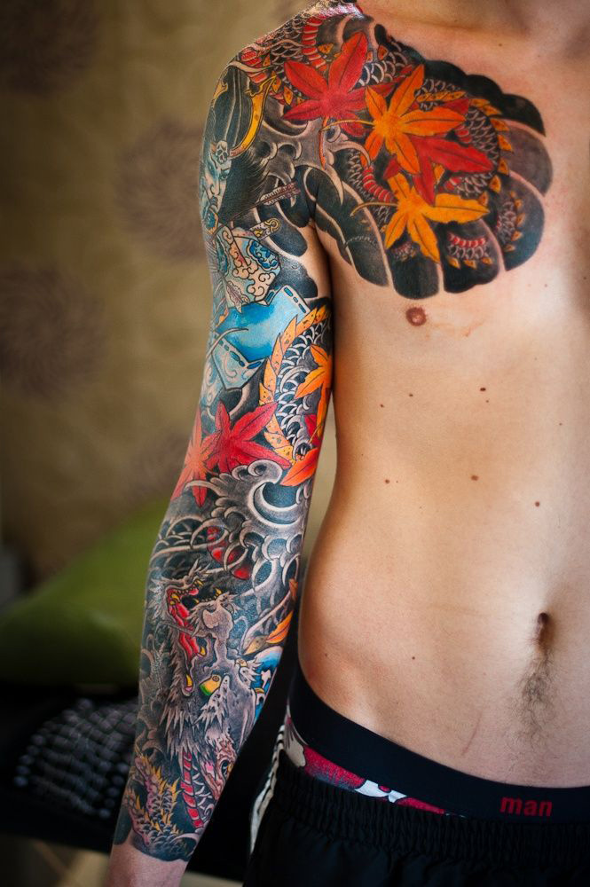 Bright Chest & Sleeve Tattoo