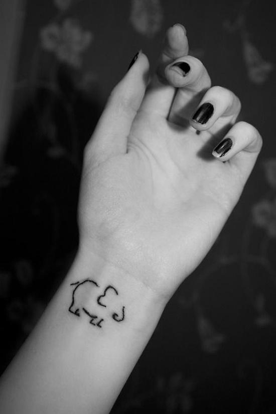 Elephant tattoos on side wrist