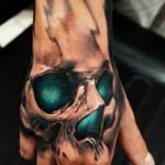 Green Glow 3D Skull Hand Tatt