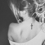 Small Cross on Back Tattoo