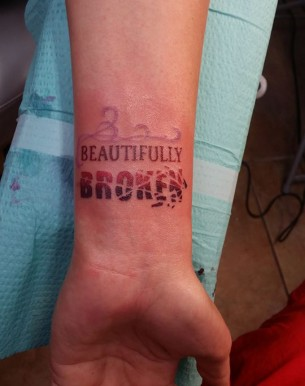Beautifully Broken Wrist Tattoo