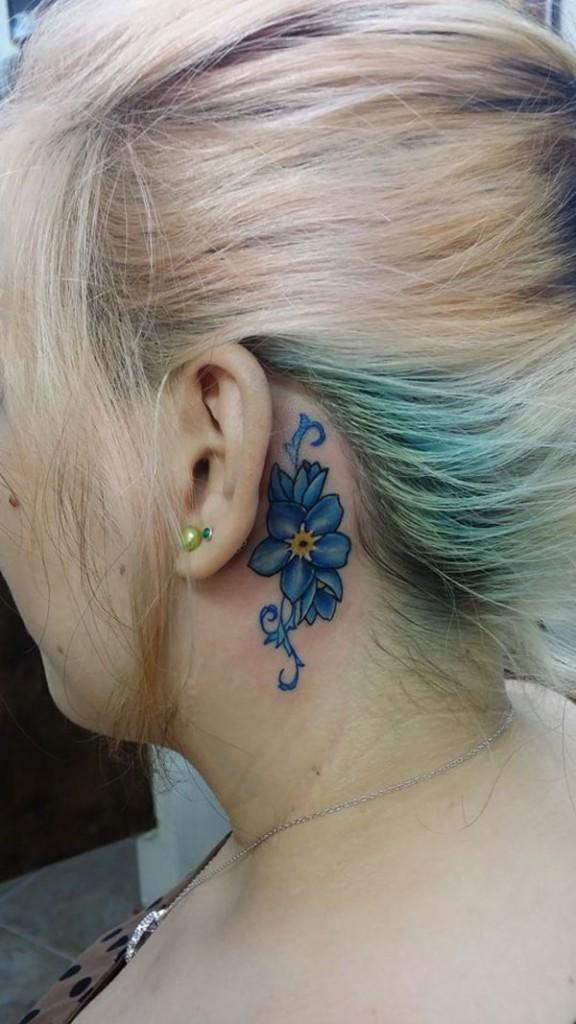 Blue Flower Behind the Ear Tattoo