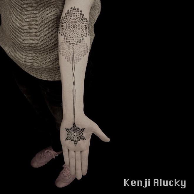 Geometric Hand To Arm Tattoo