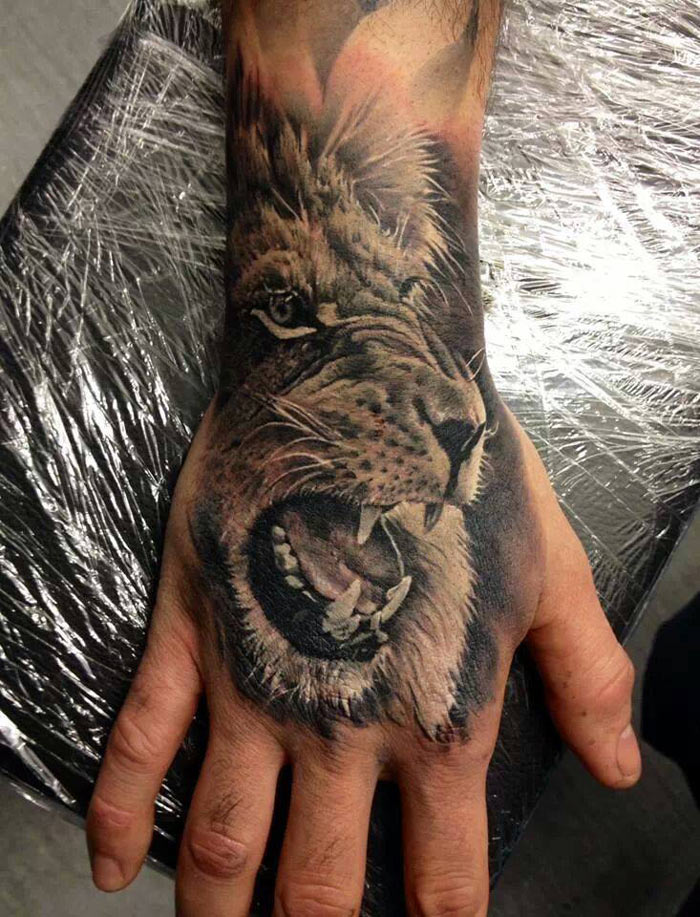Lion Hand Tattoo Best Tattoo Design Ideas