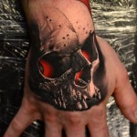 Red Glowing Skull Hand Tattoo